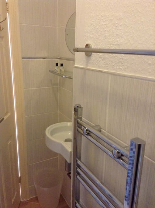 Heated towel rail and recessed modern hand basin