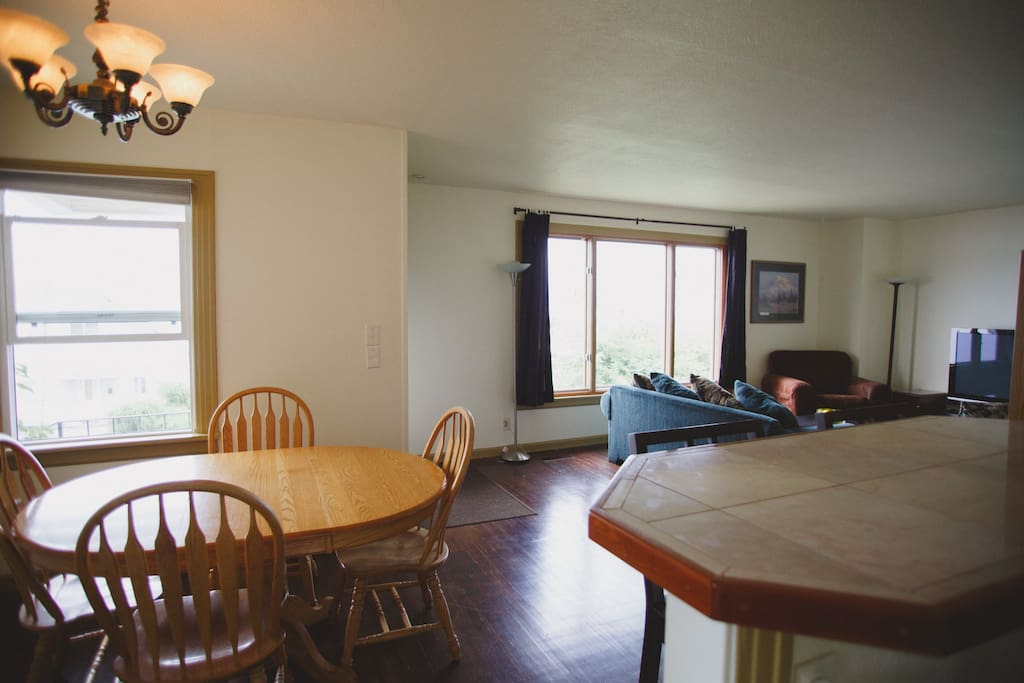 Open floor plan from kitchen to dining to living room.