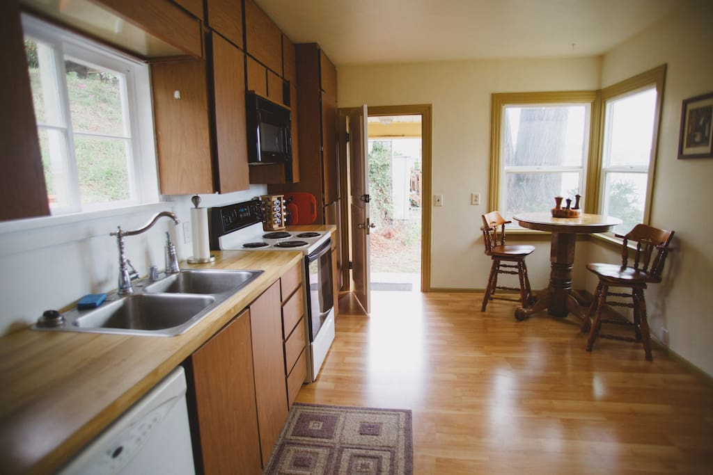 Spacious kitchen for cooking and casual dining.