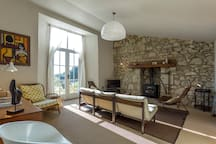Living room with natural stone wall