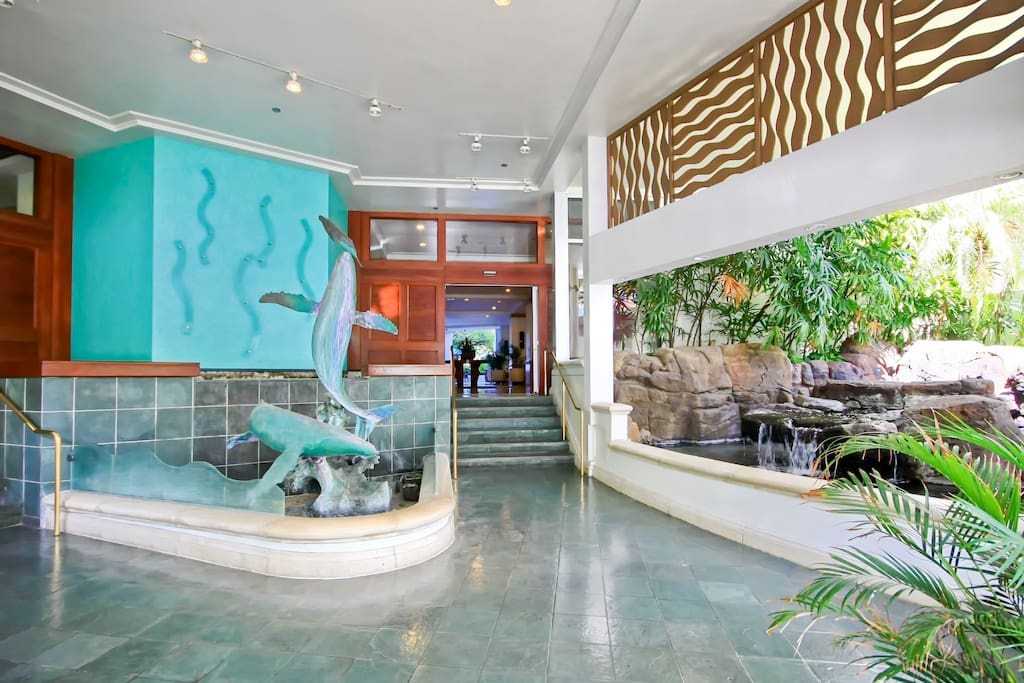 Magnificent building Porte Cochere entry with waterfalls and bronze marine statues.ilikai- on the surface of the water