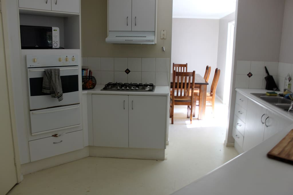 Kitchen with gas top cooker and electric oven