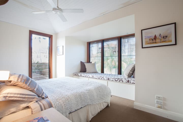 Master bedroom with king bed and garden views.