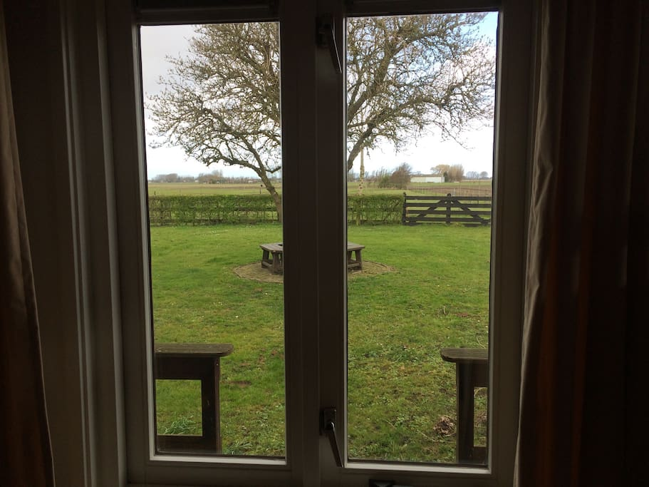 View from the bedroom window; private terrace and garden overlooking pastures