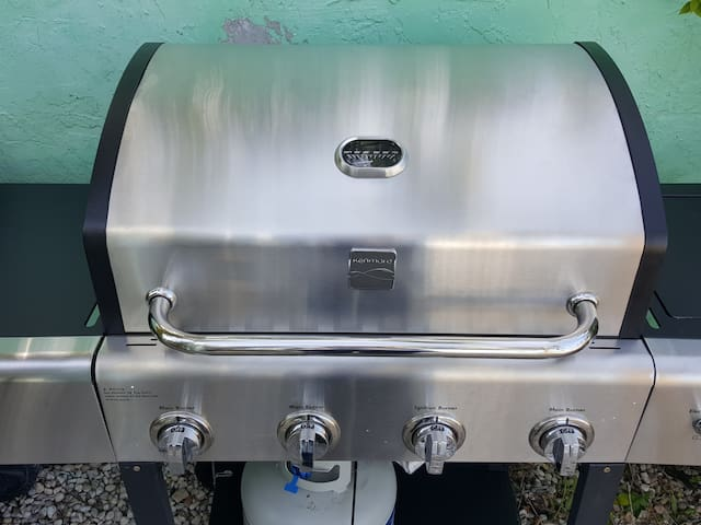 Brand new gas grill shared with the other unit