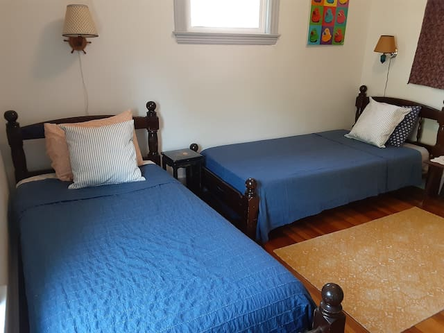 """A cozy """"guest"""" bedroom.  Beds are plenty long for an average adult."""