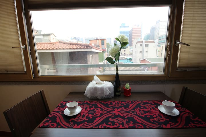 A small dining table with a view.