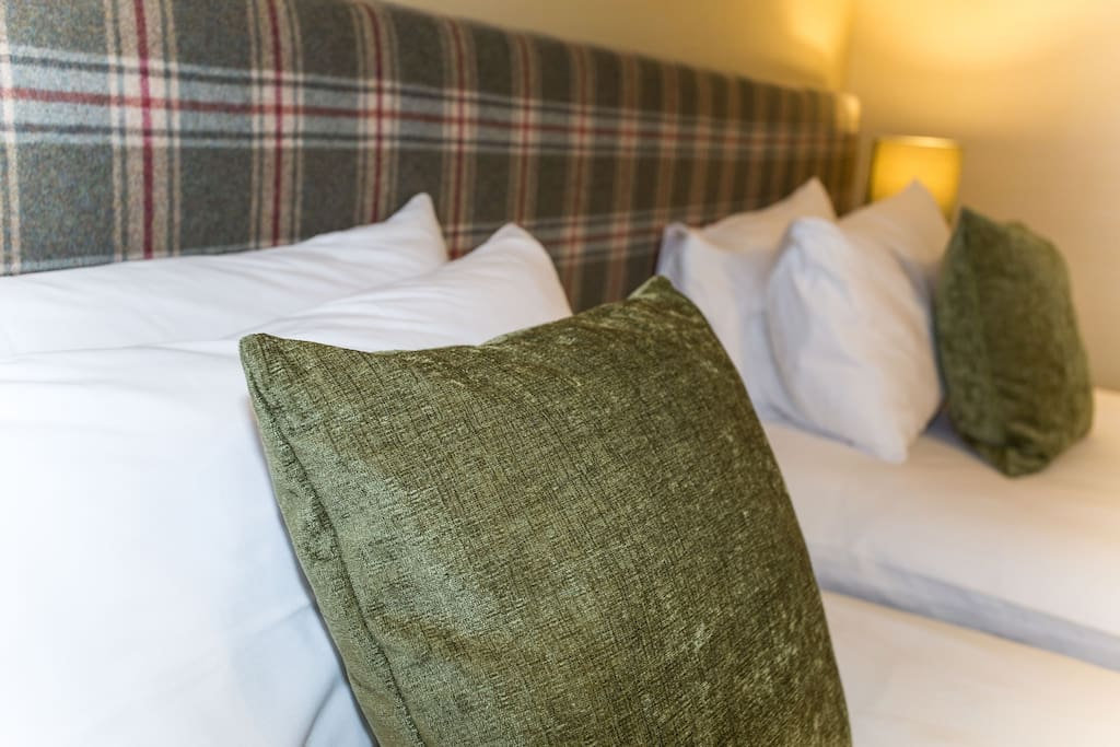 Bespoke headboards and complimentary soft furnishings give each room at Butt Lodge its own unique character