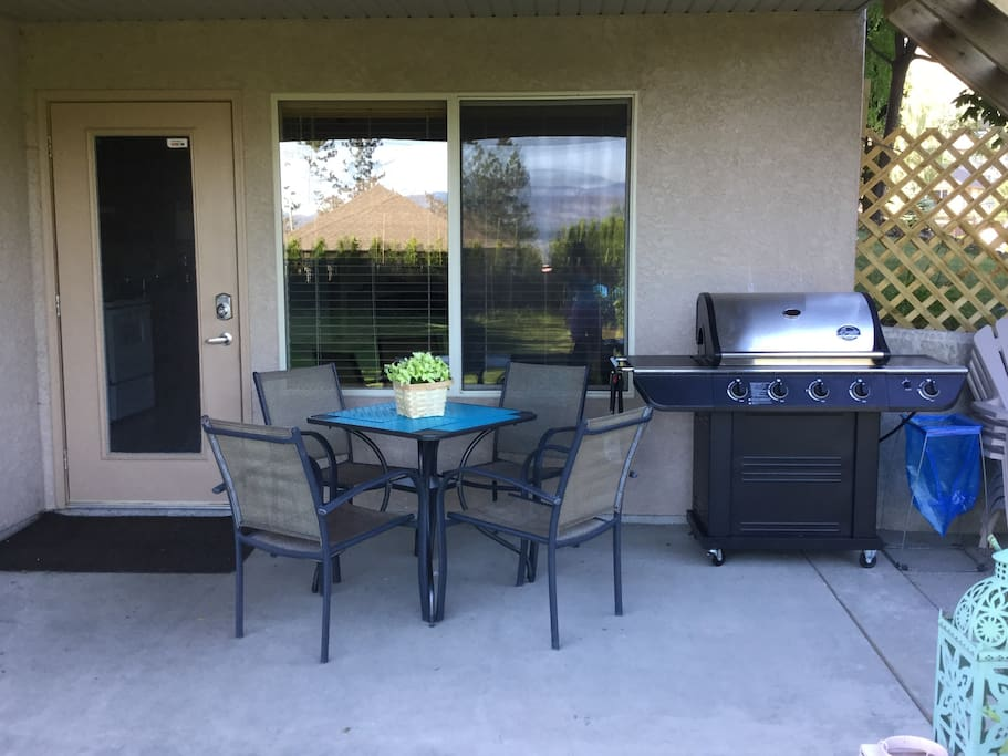 Comfortable covered patio with private entrance and BBQ for your exclusive use