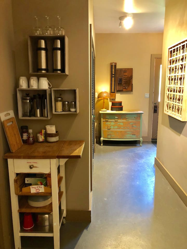 The hallway outside the bathroom... the cart/chopping block with lots of varieties of tea, organic sugar, silverware, recycled paper plates and bowls, mugs, french press and more, all for you!