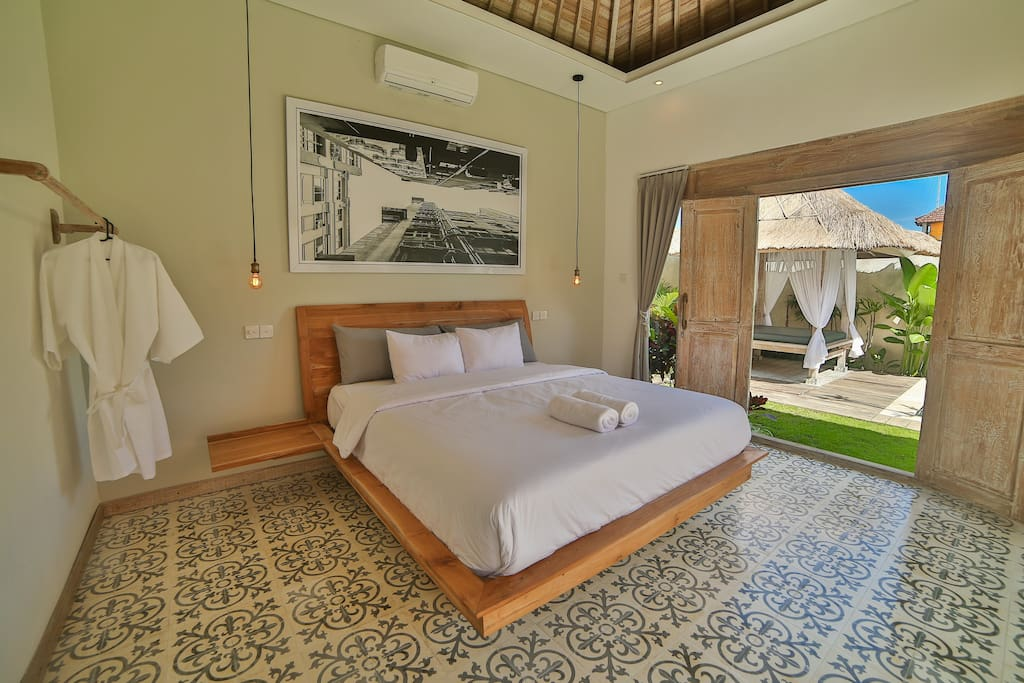 The master bedroom is situated in its own building separated only by the swimming pool and manicured yard.  It provides views of the gardens and swimming pool.