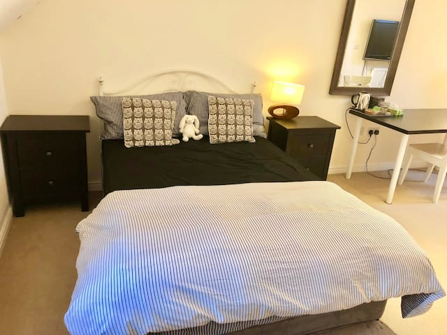 A very spacious double bedroom with own en-suite