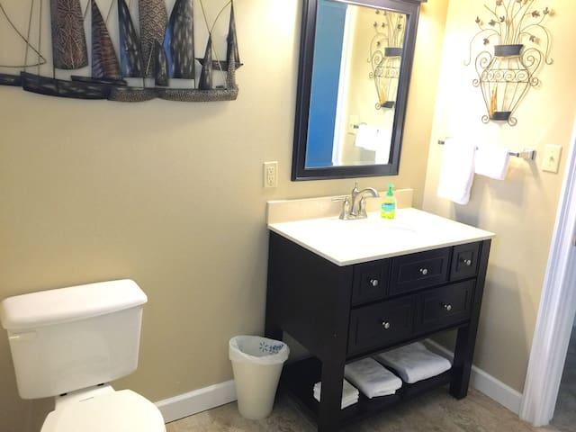Second full bath, has shower/tub combo.