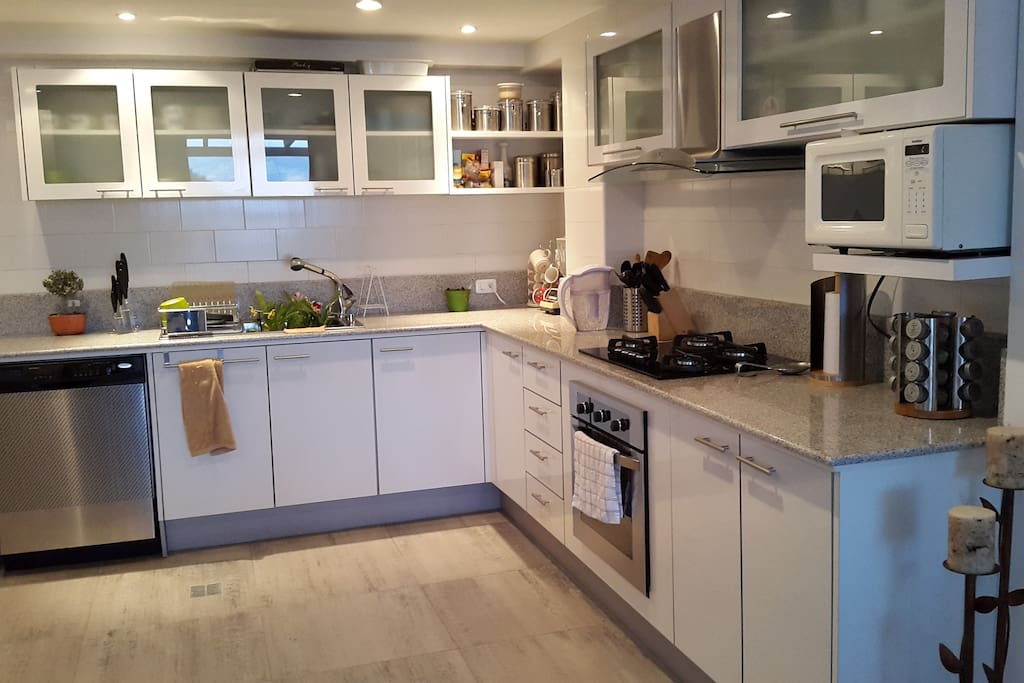 Kitchen is equipped with four burner gas stove plus an electric oven. All kitchen ware needed.