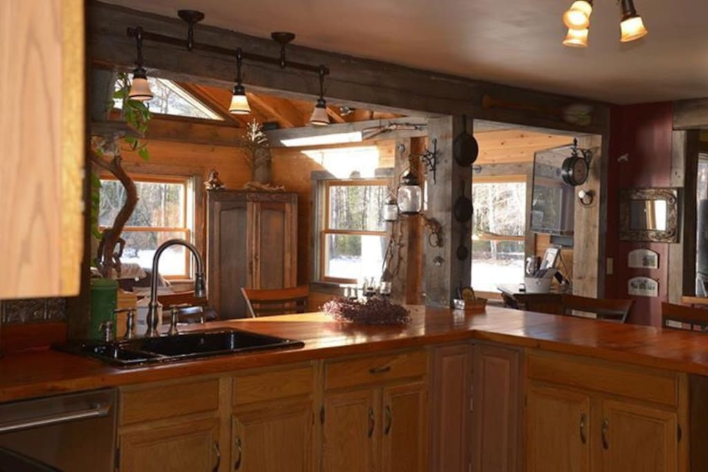 Fully equipped large kitchen with rustic appeal.