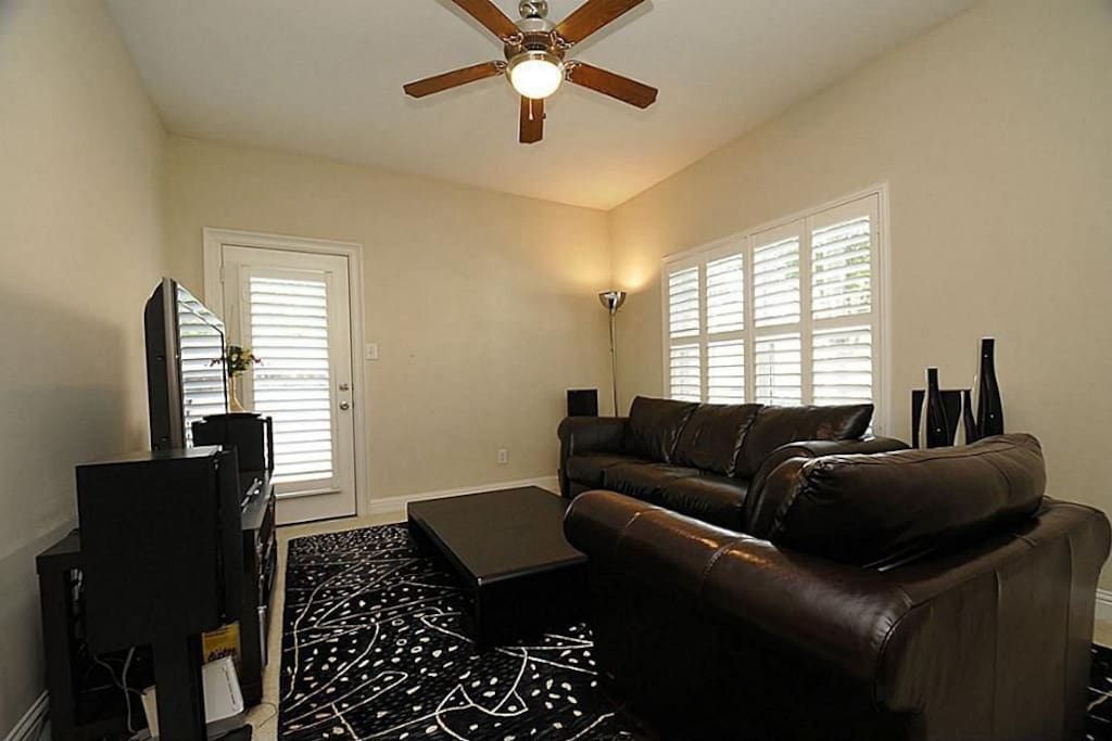 1st Floor Living Room Space- Backdoor leads to backyard. Comfy couch also available for 3rd guest.