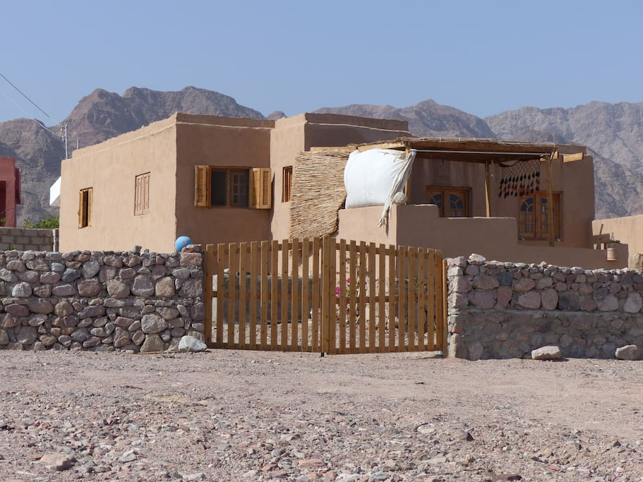 our clay covered house in front of the Sinai mountains