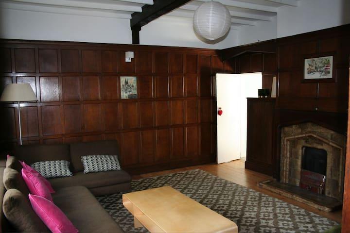 Formal lounge - original 30's oak panelling. Full of character