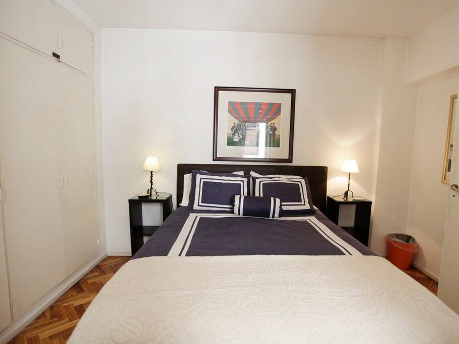Main bedroom with Queen size bed and quality mattress.