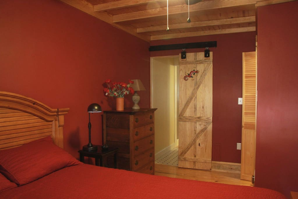 Bedroom of the Mule Room has barn door and can be made to be very dark-our night shift guests love this.