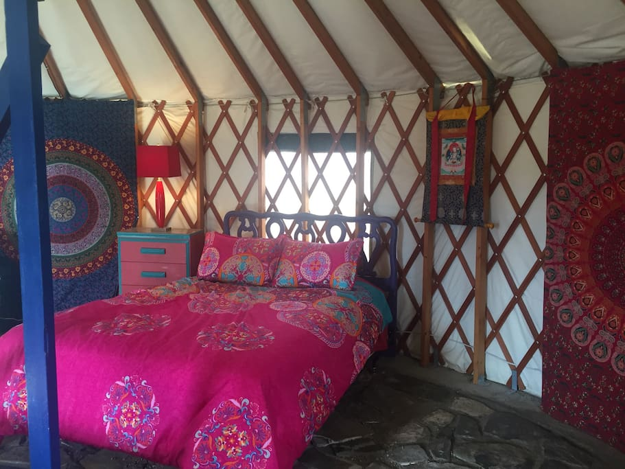 Inside the yurt there is a queen bed and a futon.
