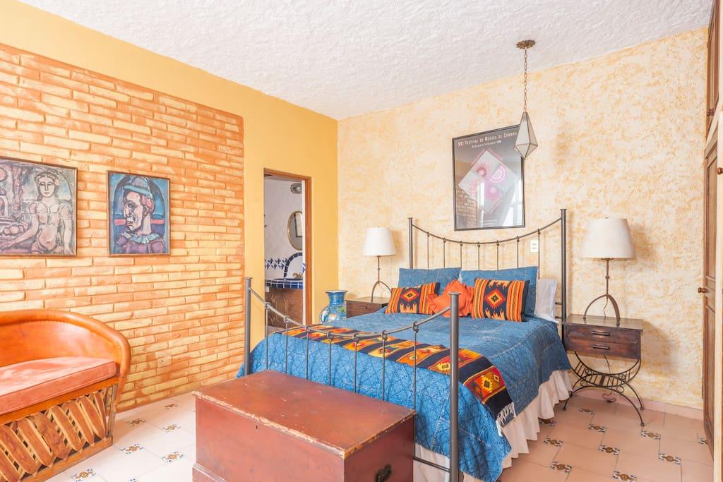 Second bedroom w/queen bed, own bathroom w/shower, opens to outdoor sitting area.