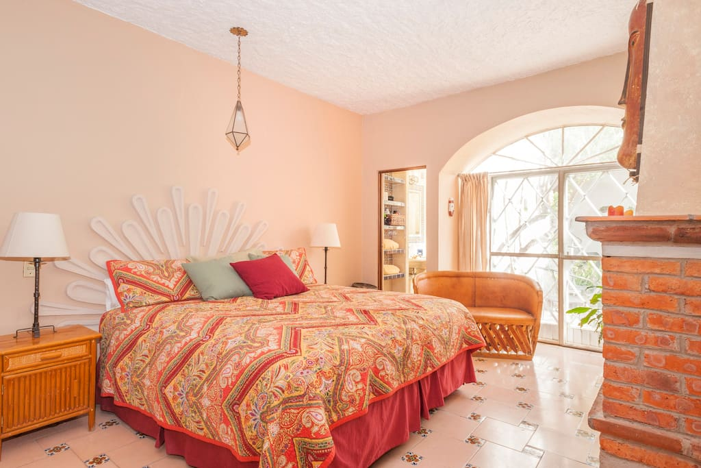 Master Bedroom w/king bed opens to garden , own bathroom w/shower