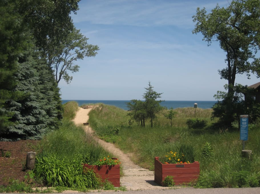 Street view of Sand dune to the beach in front of the house