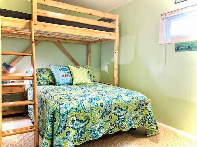 Green Bunk Room has brand new full size bed below and brand new upper twin. Upper is intended for children or pre-teens as there is limited head room.