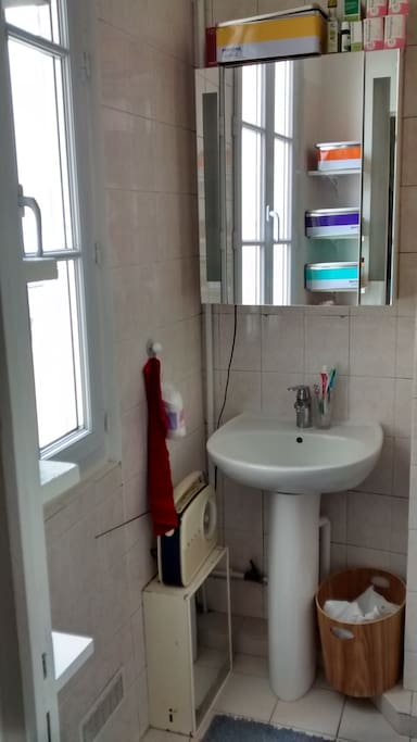 Bathroom with bath and window