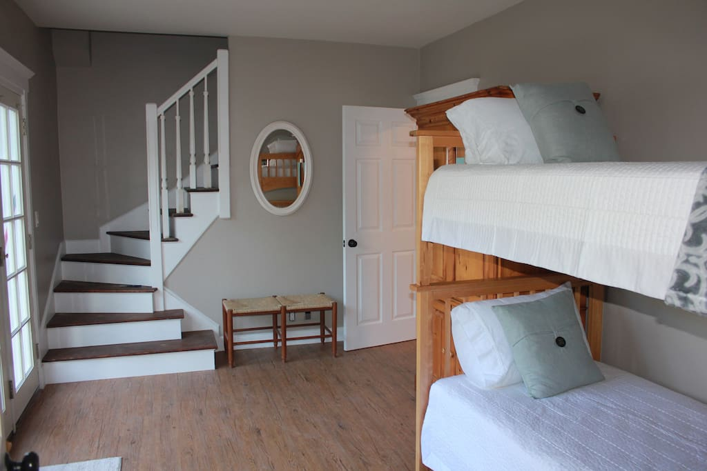 The Bunk Bed room It is the access to kitchen, bathroom and family room.  the stairs on left leads to master suite. Door to the right leads into a private bedroom with queen bed.