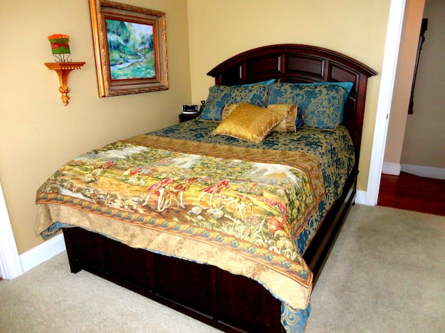 This large bedroom shares a Jack-and-Jill bath with another bedroom. This bedroom has a panoramic bay window area with a rosewood desk overlooking the historic district.