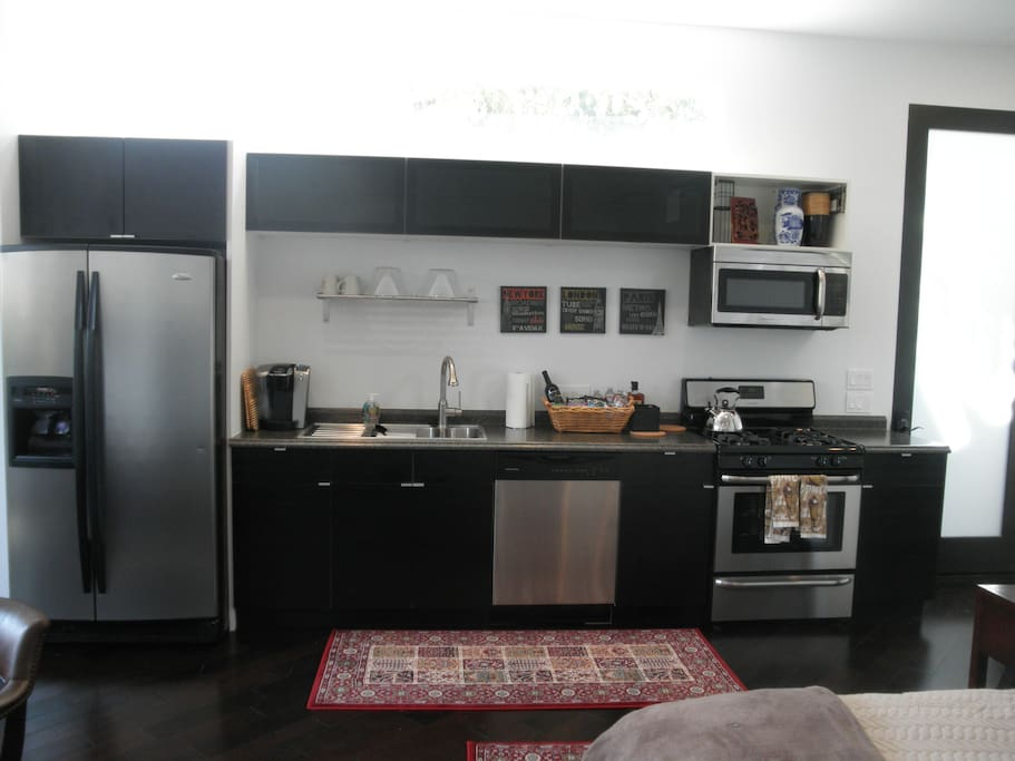 Furnished kitchen with stainless steel appliances