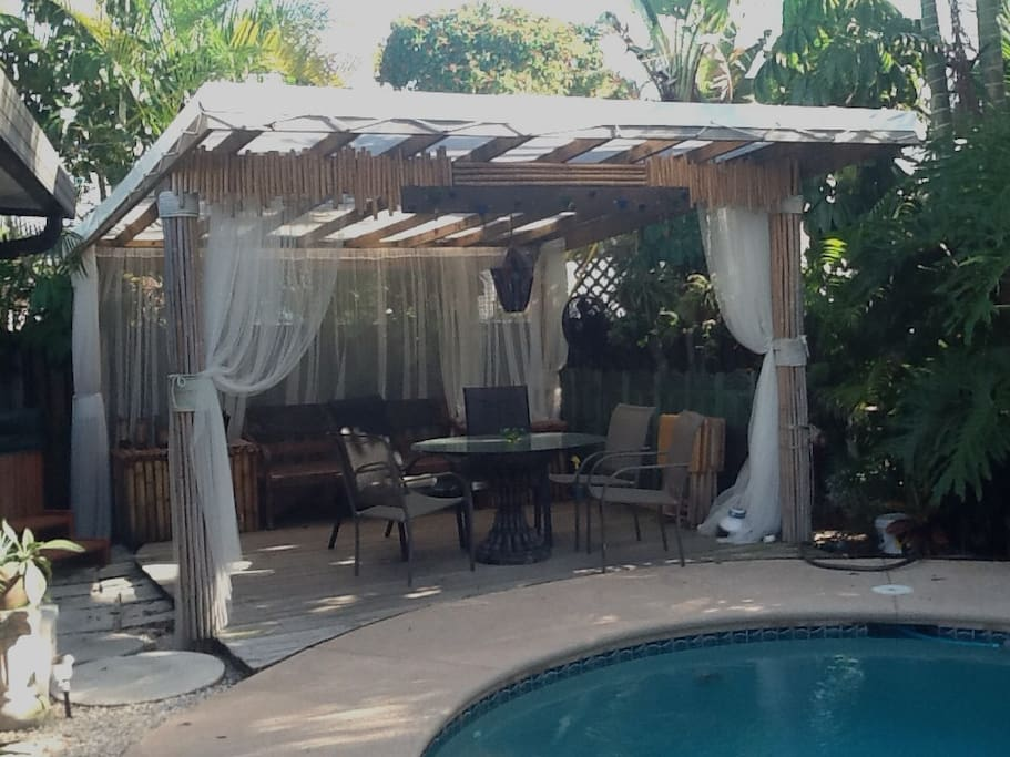 close-up of Tropical Gazebo + Outdoor Dining Table