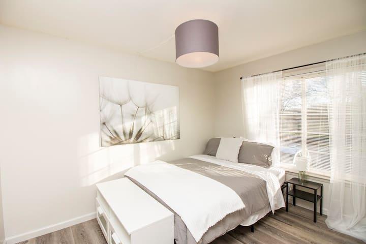 Bright bedroom with queen bed.
