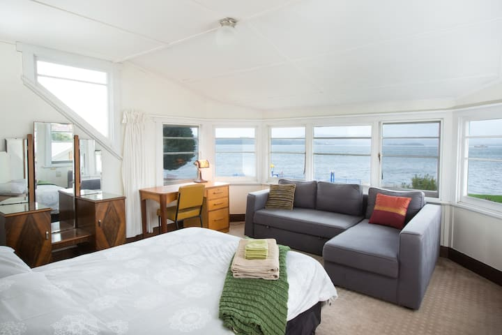 Double bedroom with sofa bed overlooking the deep water harbour of the Tamar River.