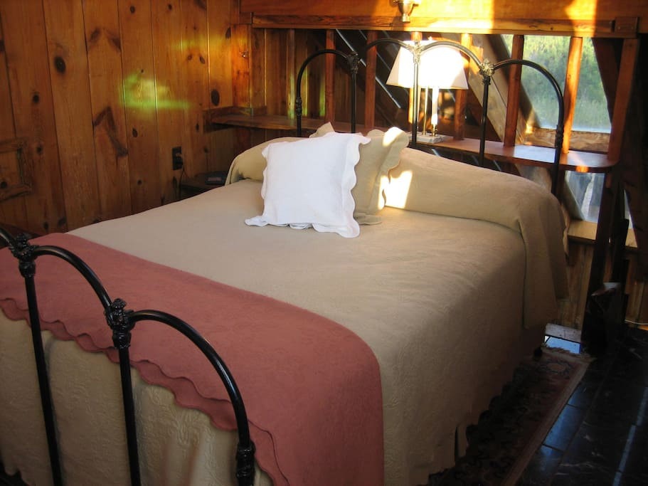 The sleeping loft has a full size bed.
