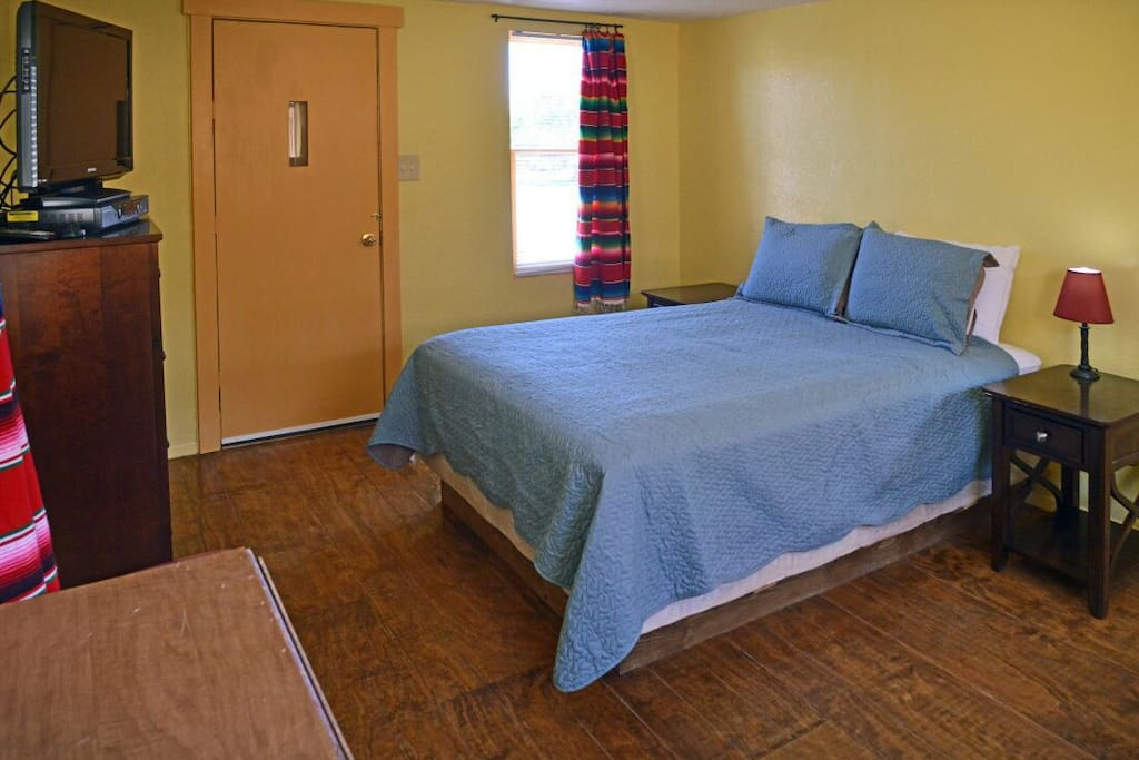 The bedroom, flat screen cable tv, wifi, queen size bed.