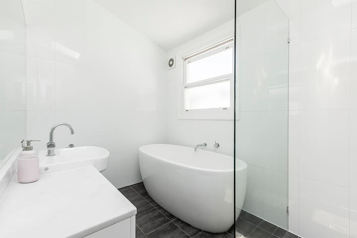 Freshly painted bathroom for you to use