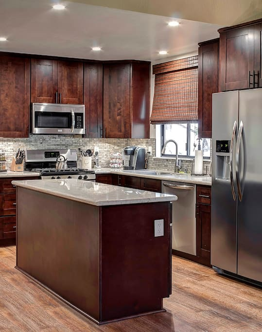 Gourmet Kitchen | Stainless, stone & hardwood. Premium appliances. All cookware