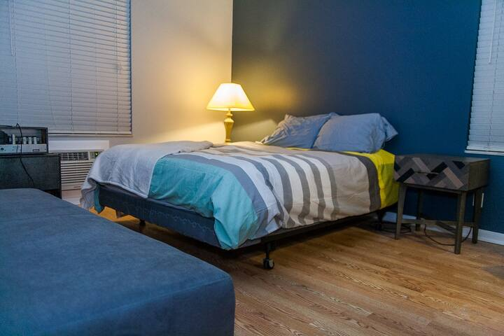 Queen bed with West Elm couch that converts to twin bed