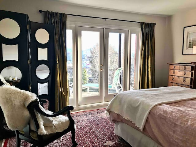 French doors lead to the private, covered, view patio. The bedroom also features silk draperies, a Persian rug, antique dresser and rocking chair plus a closet fitted with hangers, shoe storage, full size ironing board and new iron.