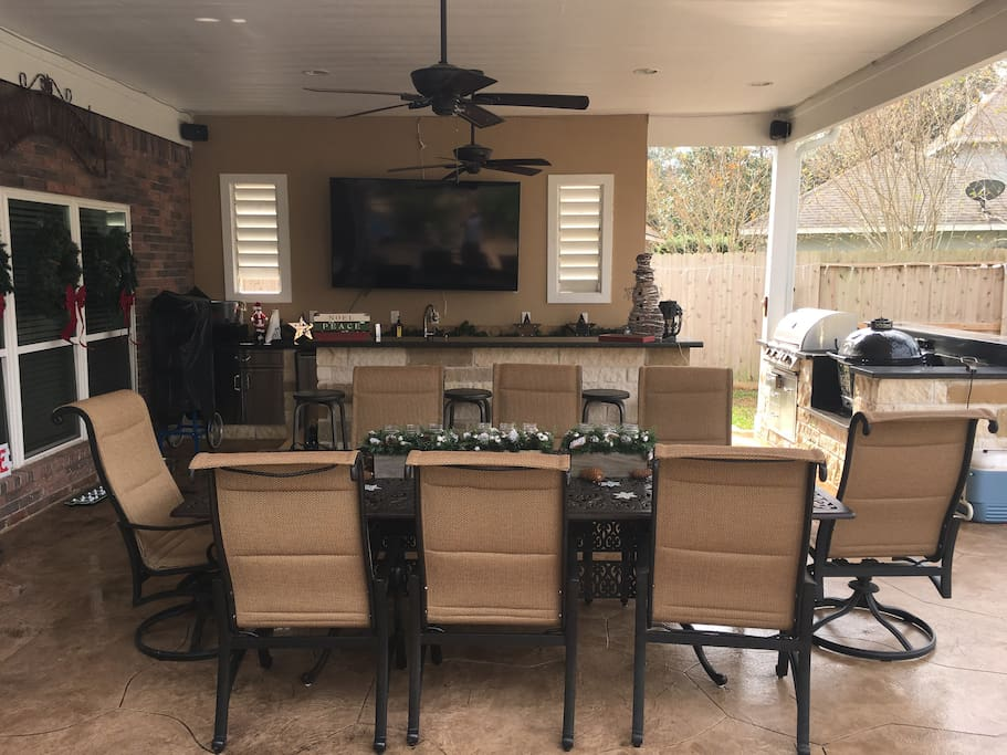 "Outdoor covered area:  8ft bar, 80"" TV with surround sound, 2 grills, giant outdoor table.  Outdoor kitchen includes oven, dishwasher, ice machine, beer fridge, wine fridge and sink."