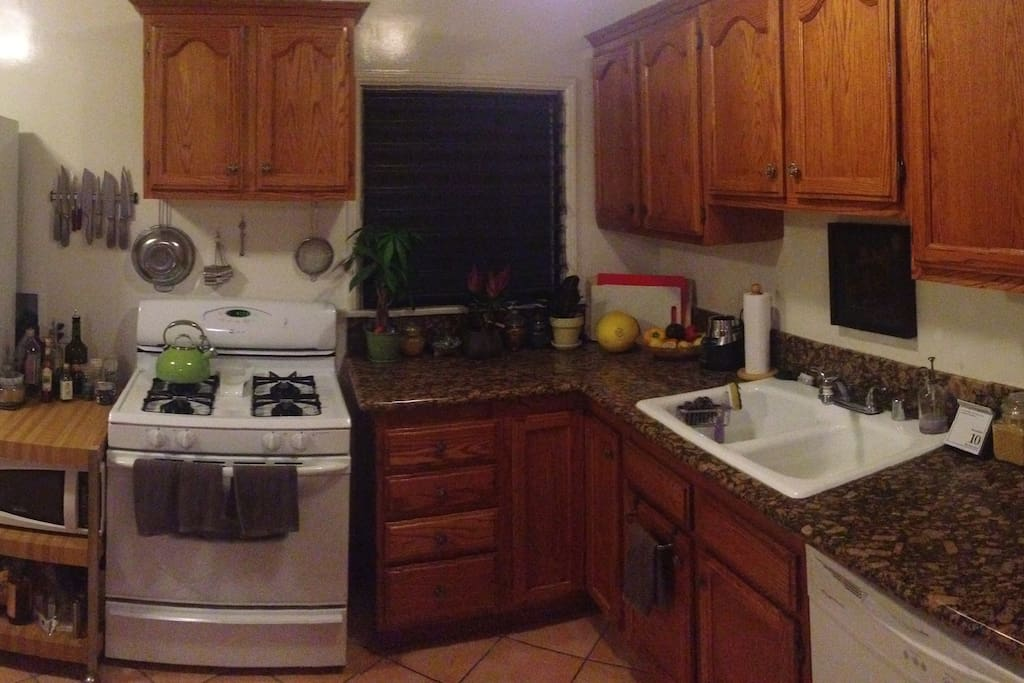 Spacious kitchen with full equipment and amenities, washer/dryer/dishwasher in unit