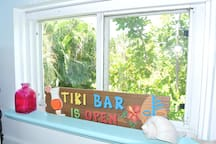 Kitchen window with beautiful tropical view.