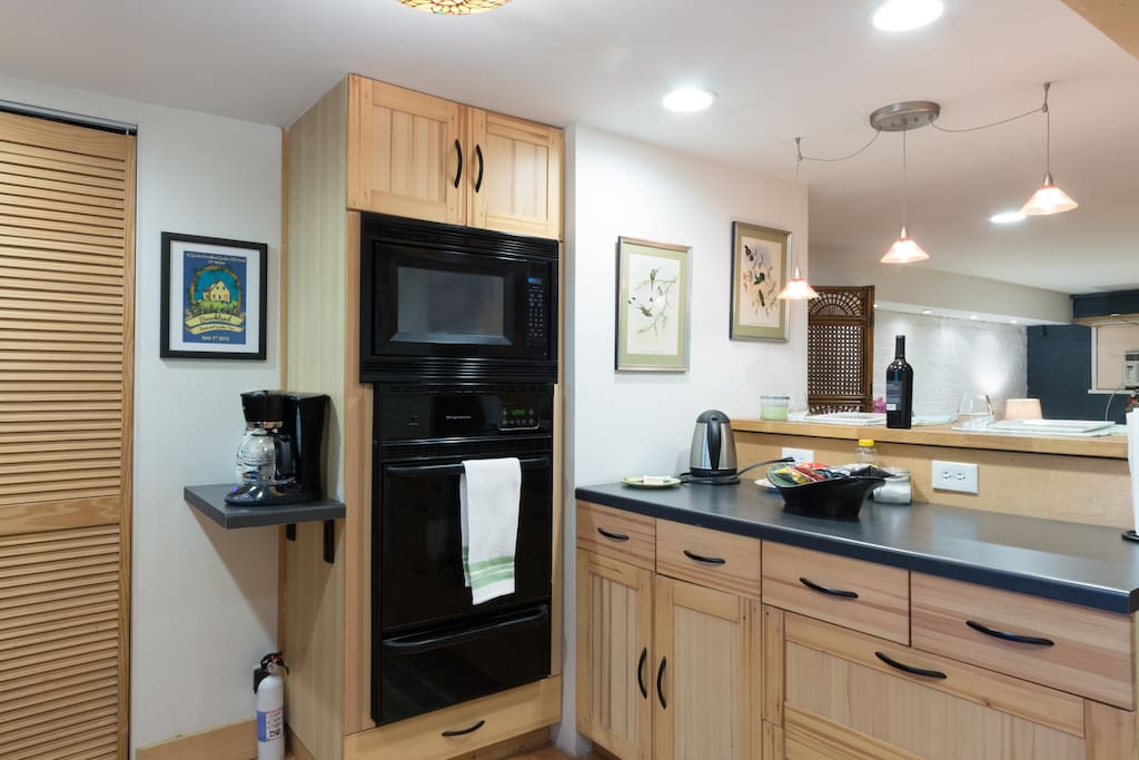 Gas oven, microwave and coffee bar.