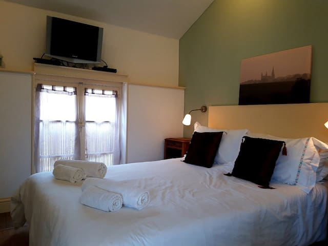 Bedroom.  Rosemary has a comfortable double bed with quality linens.  We want you to have the most relaxing holiday possible.