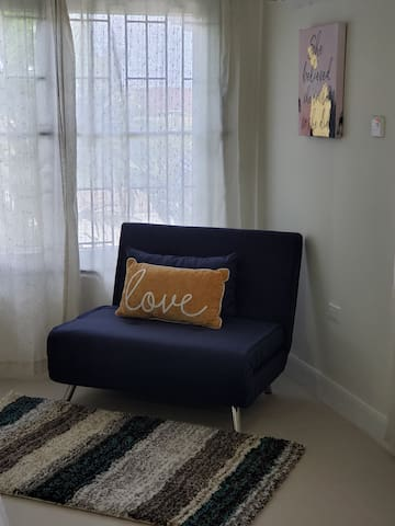 Sitting Area in master br. This sofa also doubles as a bed for extra sleeping space