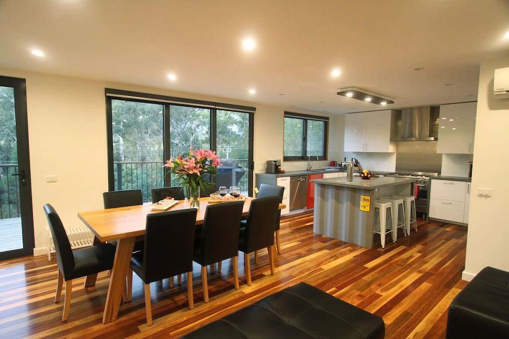 Open plan living, with kitchen, lounge and dining.