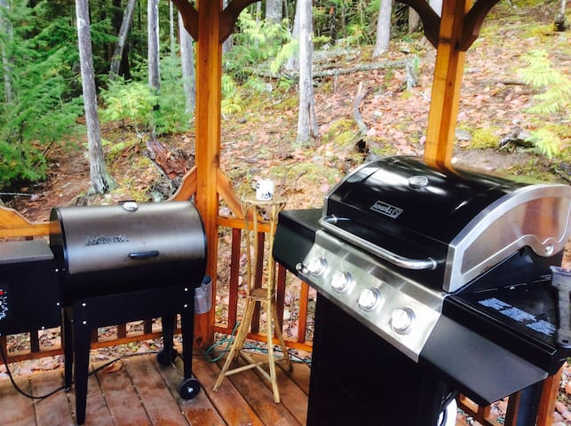 Two meat smokers and BBQ
